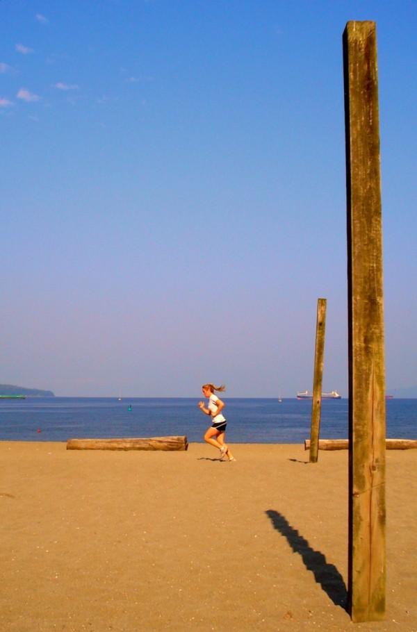 Runner at English Bay beach, Vancouver