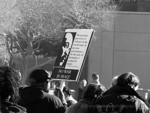Anti-war protest picket sign on MLK Day