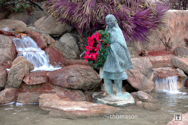 Statue of woman at the water