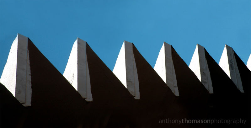 Jagged Building Edge against Blue Sky