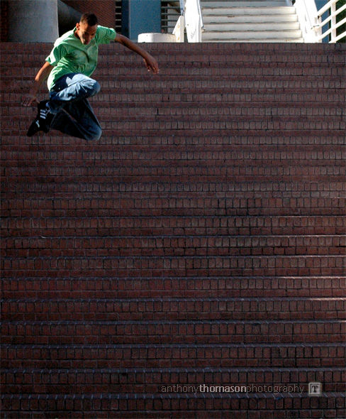 Young man jumping off steps
