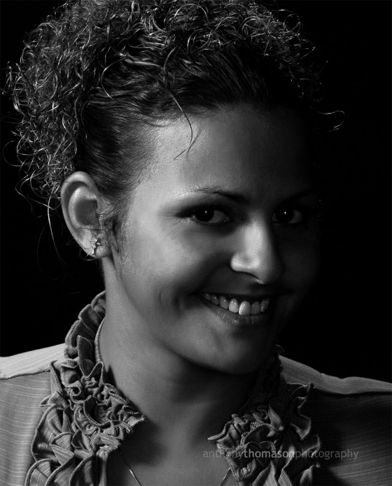 Smiling woman in black and white