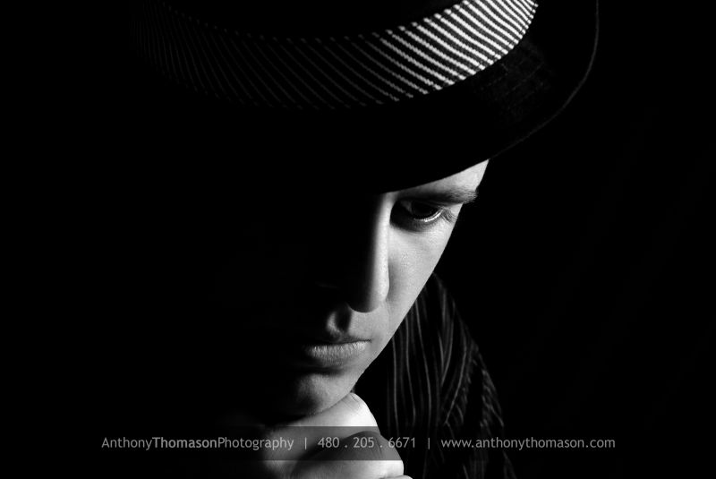 Black & white of male in fedora