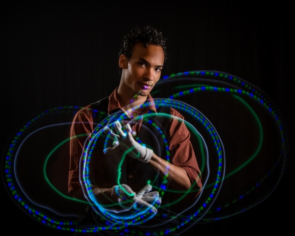 Slow shutter with flash of male with glove lights
