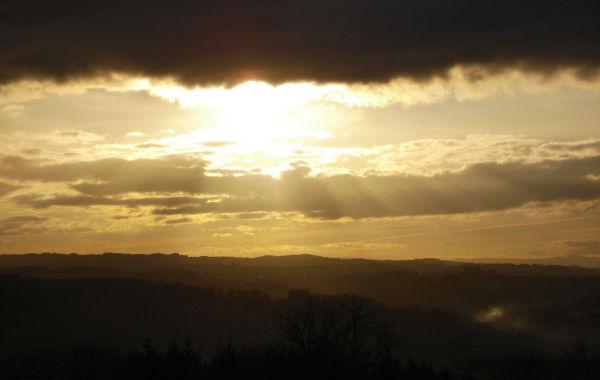 setting sun behind clouds