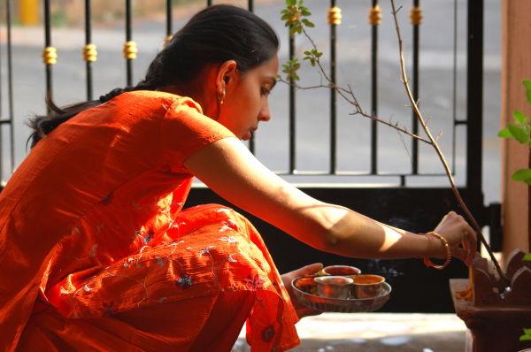 Performing Tulsi Pooja