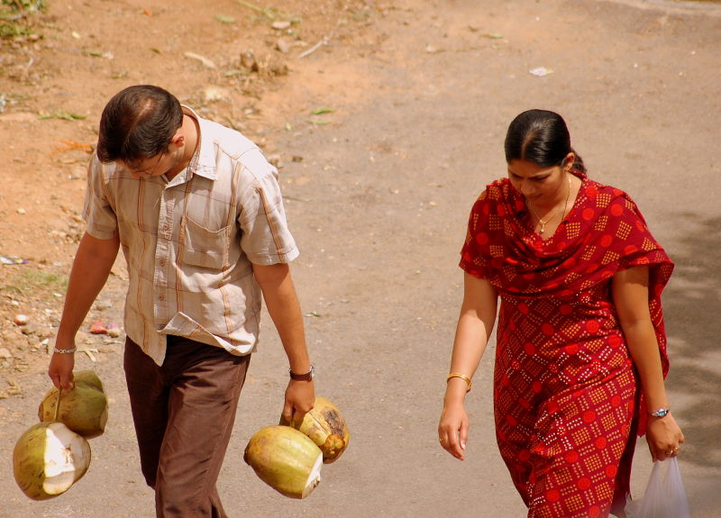 Carrying coconut
