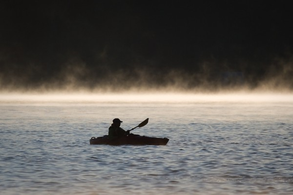 A guard boat at the Reeds Lake Triathlon
