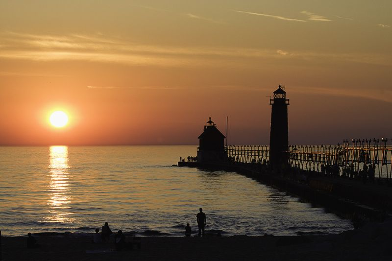 The sun sets over Lake Michigan in Grand Haven Mic