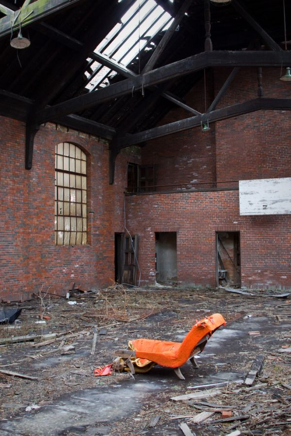 Chair in a decaying gymnasium