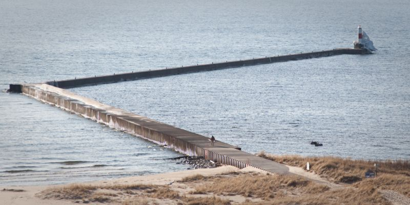 A fisherman working his way out the pier at Frankf