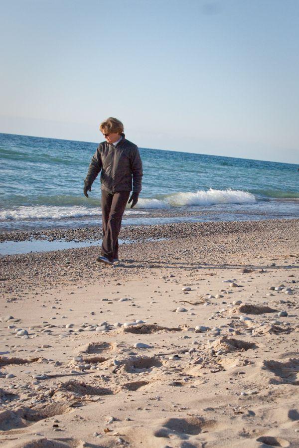 A walker on the beach at Pt Betsie Lighthouse