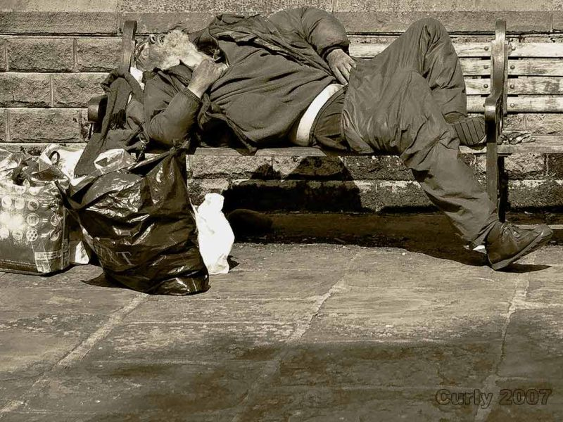 Itinerant sleeping on bench, Skipton, Yorkshire