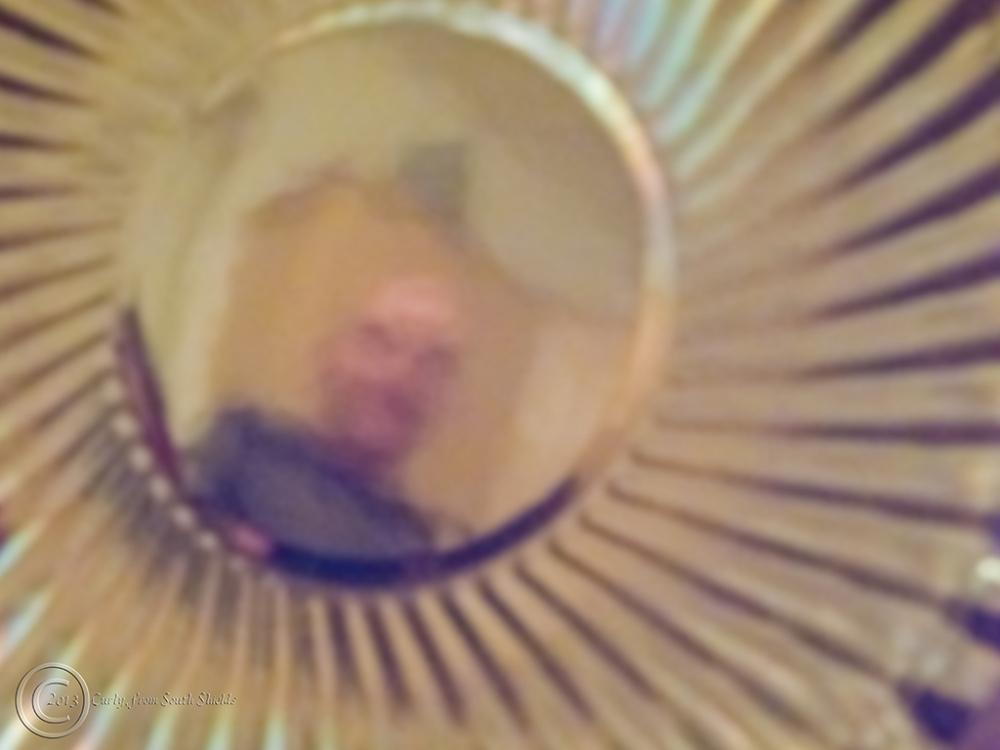 Self portrait in a button