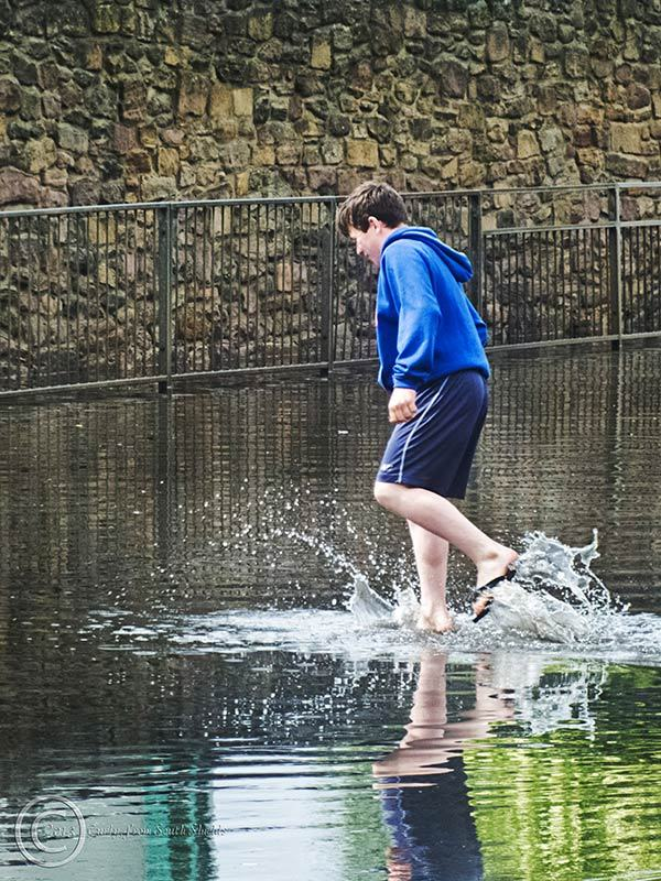 Boy in puddle at Tyne Dock, South Shields