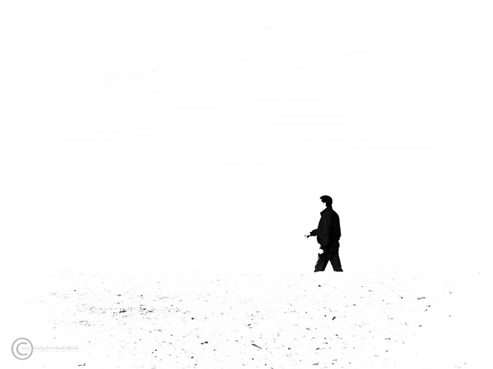 Man on Littlehaven Beach, South Shields, UK