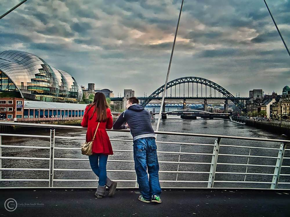 Couple looking at the River Tyne, Newcastle, UK