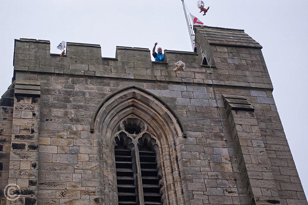 Teddy bears parachute from parish church, Rothbury