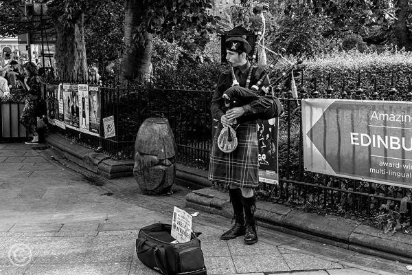 Piper outside Waverley Station, Edinburgh