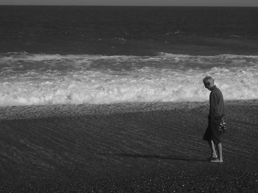 My dad walking along the beach