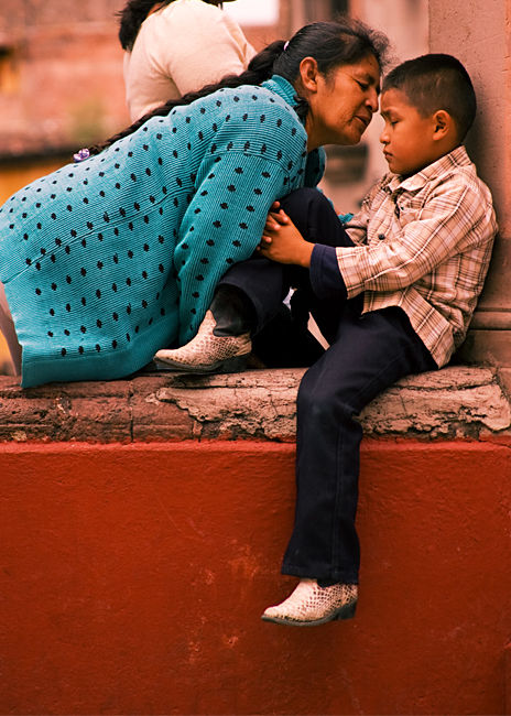 abuela kissing boy