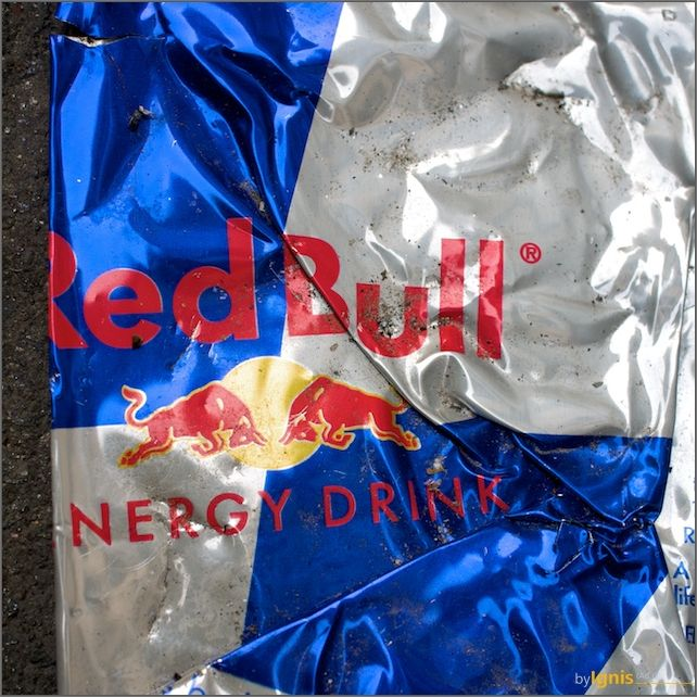 a flattened can of red bull