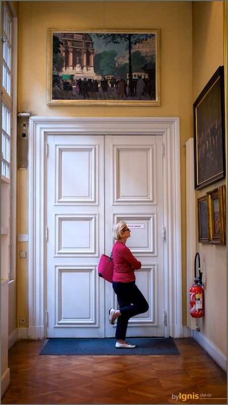 museum visitor in front of a white door
