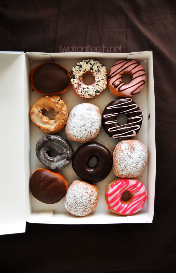 a dozen of krispy kream donuts