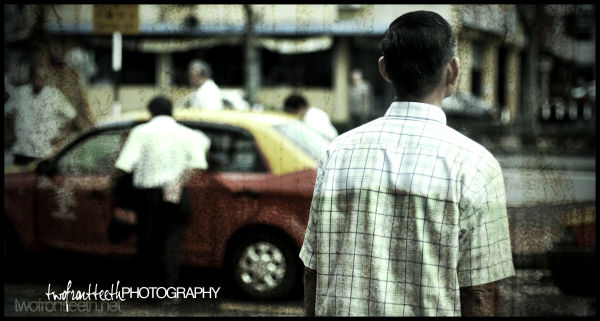 old man in sibu sarawak with taxis
