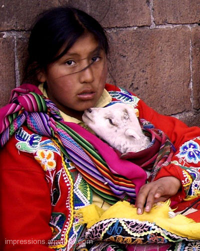 Peruvian girl and her little friend.