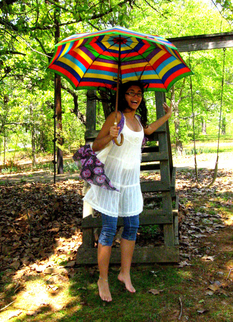 Jumping with a Rainbow Umbrella