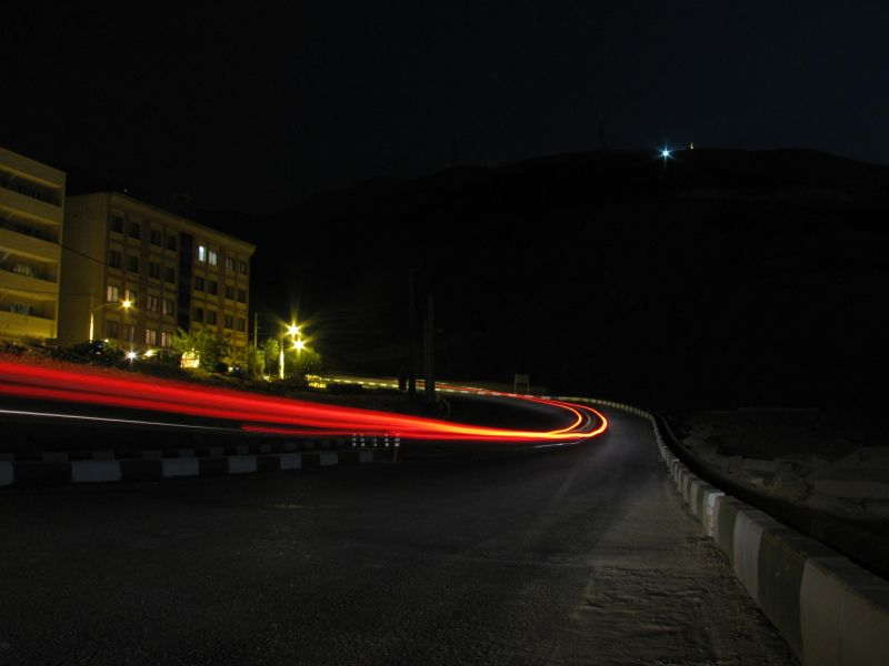 Car passing in the dark