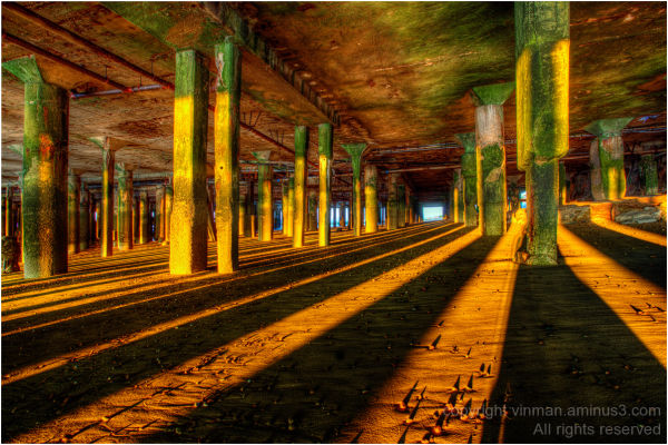Under Clacton Pier at dawn