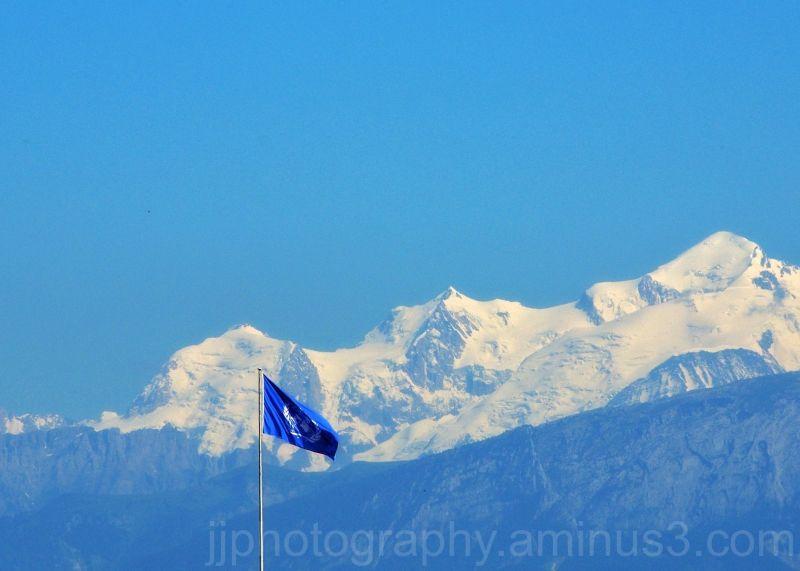 UN Flag against alps