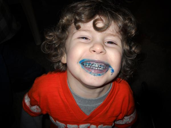 A boy enjoying some cake