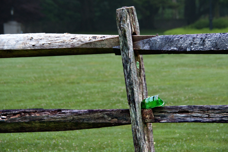 A fence and broken bottle