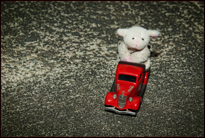 Little toy sheep on a coca cola truck