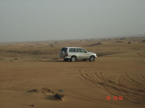 Car moving towards abu dhabi border for a ride