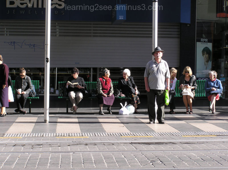 People waiting for a tram