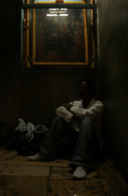 Man sitting inside church