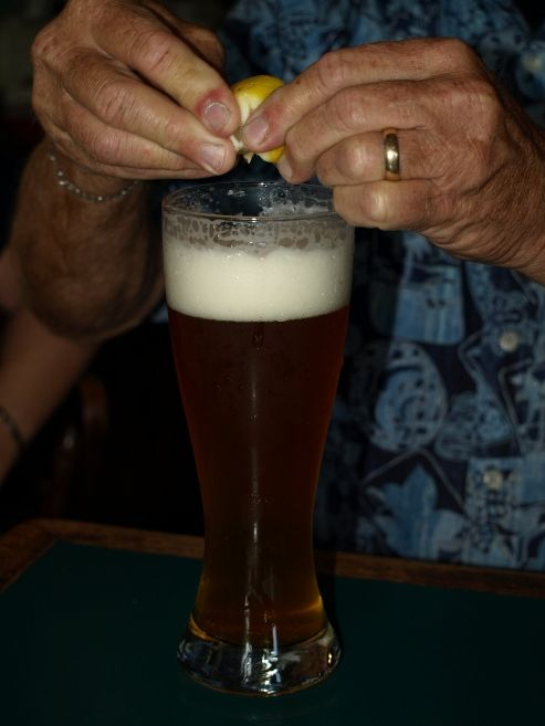Squeezing lemon into beer