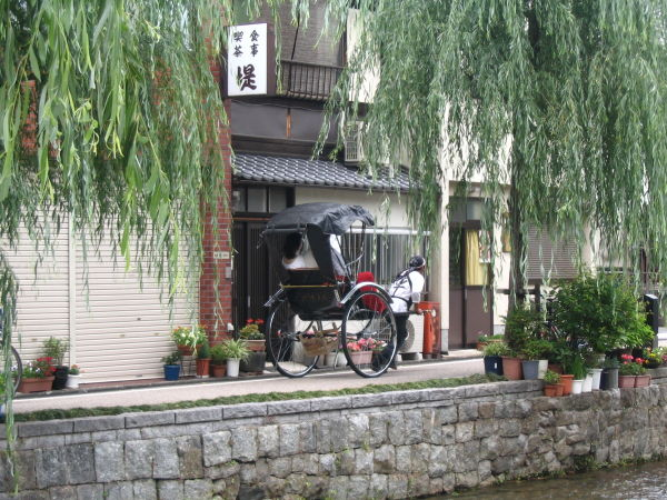 A man pulling a cart in Kyoto