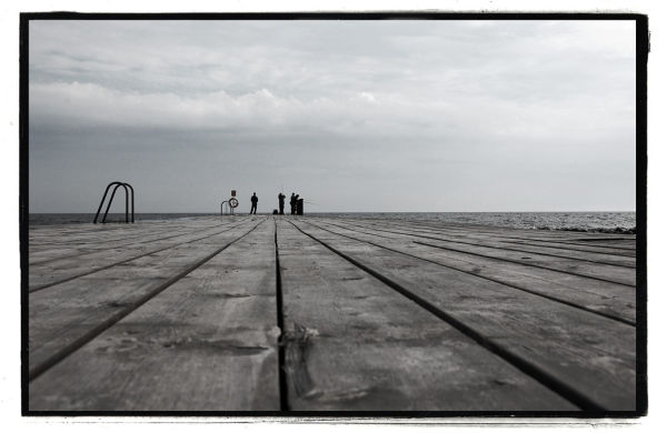 Some guys fishing on a pier