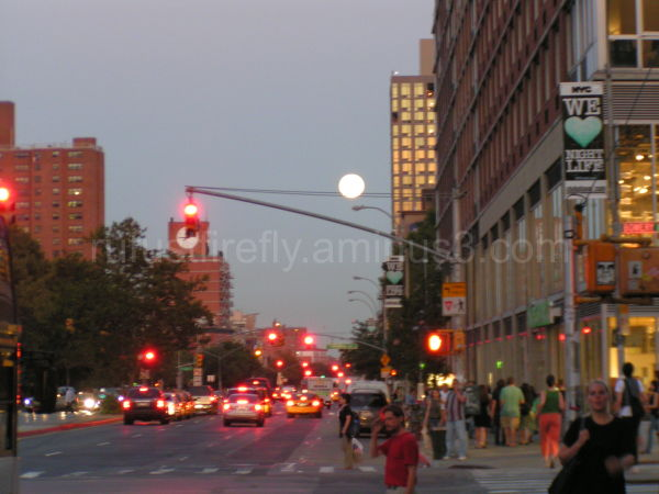 Full moon over Lower East Side on Houston