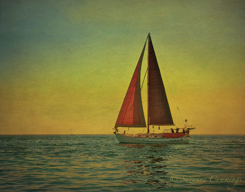 Sailboat with red sails