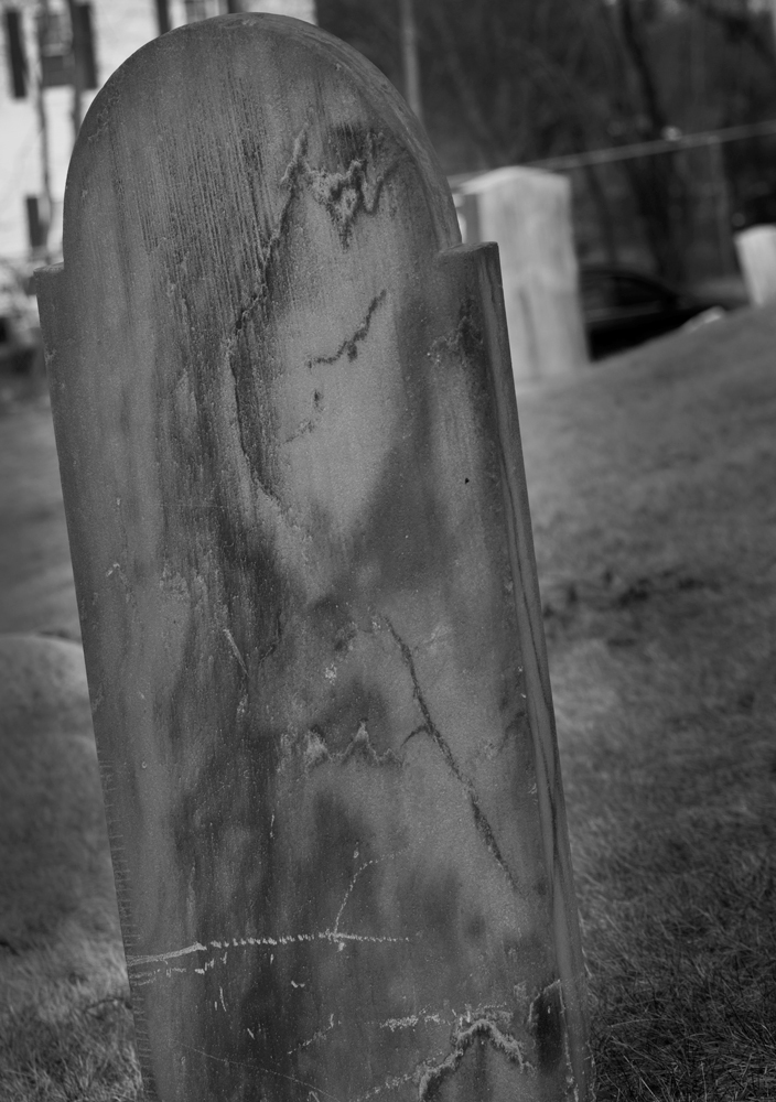 Tombstone stained by decades of exposure