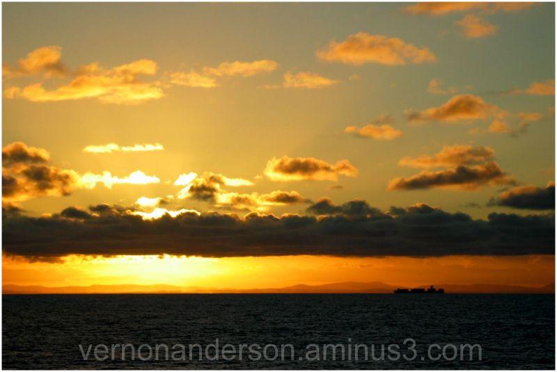 sunset sea ship