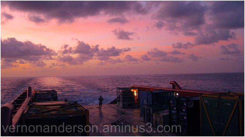 sea ship sunset clouds