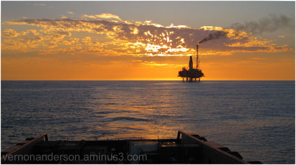 sunset oil platform ocean