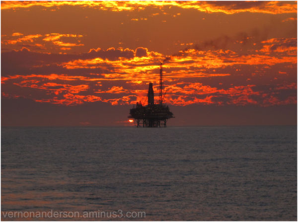sunset oil platform ocean